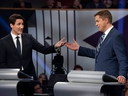 Conservative Leader Andrew Scheer (right) and Liberal Leader Justin Trudeau gesture to each other as they both respond during the Federal Leaders Debate at the Canadian Museum of History in Gatineau, Que., on Monday, Oct. 7, 2019.