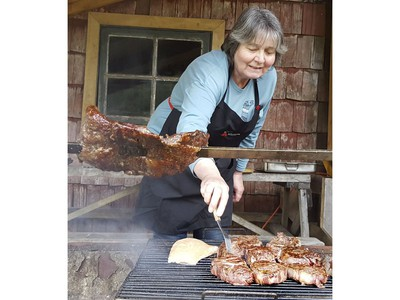 Maria Elena cooks up steaks at the Los Copihues restaurant in Chile on Saturday September 7, 2019. Veronica Henri/Toronto Sun/Postmedia Network