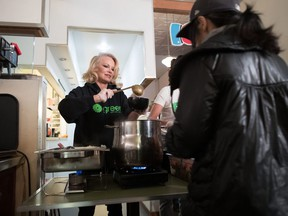 Actress and animal rights activist Pamela Anderson serves free vegan meals during an event held by Green Party candidate for East Vancouver Bridget Burns to register voters for the federal election, in the downtown Eastside of Vancouver, on Wednesday October 9, 2019.