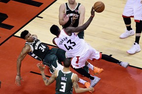 Milwaukee Bucks forward Giannis Antetokounmpo fouls out of the game as Toronto Raptors forward Pascal Siakam drives to the net during the Eastern Conference final earlier this year. (THE CANADIAN PRESS)
