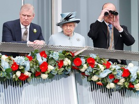 Britain's Queen Elizabeth watches the Epsom Derby with Prince Andrew (L) and Prince Philip, the Duke of Edinburgh, in Epsom, south of London on June 1, 2013. (Reuters)