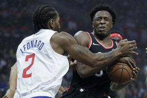 Toronto Raptors forward OG Anunoby reacts after getting hit in the eye by Los Angeles Clippers forward Kawhi Leonard during Monday's game. (AP PHOTO)