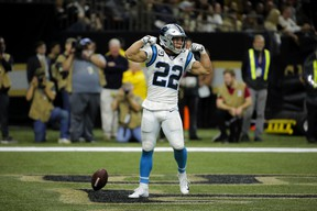 Carolina Panthers running back Christian McCaffrey  celebrates after scoring a touchdown against New Orleans on Sunday. (USA TODAY SPORTS)