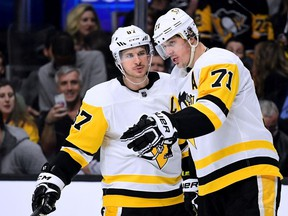 Sidney Crosby and Evgeni Malkin of the Pittsburgh Penguins talk before the faceoff of a power play against the Los Angeles Kings during the third period of a Penguins win at Staples Center on January 18, 2018 in Los Angeles, California.