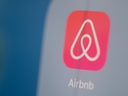 This photo illustration shows the Airbnb app on a tablet screen.
