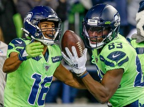 Seahawks wide receiver David Moore (right) celebrates a touchdown with  teammate Tyler Lockett in the third quarter against the Minnesota Vikings in Seattle last night. Getty Images