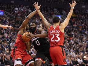 Houston Rockets guard James Harden, centre, drives between Toronto Raptors forward OG Anunoby, left, and guard Fred VanVleet, right, during the first half at Scotiabank Arena, Dec. 5, 2019. (John E. Sokolowski-USA TODAY Sports)
