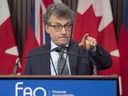 Ontario Financial Accountability Officer Peter Weltman answers questions in Toronto on Monday December 10, 2018. THE CANADIAN PRESS/Frank Gunn
