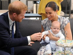 The Duke and Duchess of Sussex, Prince Harry and wife Meghan, hold son Archie as they meet with Archbishop Desmond Tutu (unseen) at the Tutu Legacy Foundation  in Cape Town on September 25, 2019.  HENK KRUGER/AFP/Getty Images