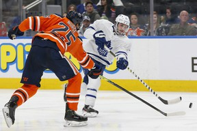 Maple Leafs forward Alexander Kerfoot takes a shot against the Edmonton Oilers during the second period at Rogers Place on Saturday night. Kerfoot had a goal and an assist on Saturday night. (Perry Nelson/USA TODAY Sports)
