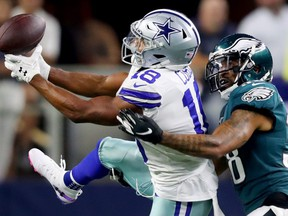 Cowboys receiver Randall Cobb (left) attempts to make a catch against the Eagles during first half NFL action in Arlington, Texas, on Oct. 20, 2019.