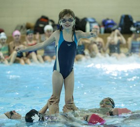 Kyra Menzie, 7, practices for her synchro swimming pyramid at Variety Village on Tuesday, Dec. 10, 2019. (Craig Robertson/Toronto Sun/Postmedia Network)