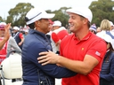 Playing captain Tiger Woods and Bryson DeChambeau of the U.S. team celebrate winning the Presidents Cup during Sunday Singles matches of the 2019 Presidents Cup at Royal Melbourne Golf Course in Melbourne, Australia, on Sunday, Dec. 15, 2019.