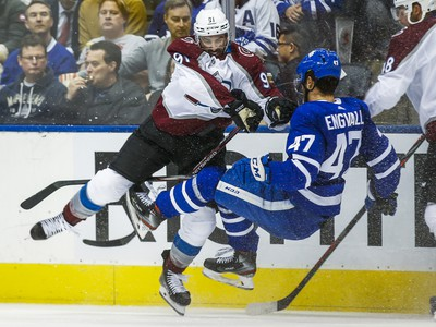 Toronto Maple Leafs Pierre Engvall is checked during 3rd period by Colorado Avalanche Nazem Kadri at the Scotiabank Arena in Toronto on Wednesday December 4, 2019. Ernest Doroszuk/Toronto Sun/Postmedia