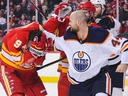 Zack Kassian of the Edmonton Oilers fights Matthew Tkachuk of the Calgary Flames during an NHL game at Scotiabank Saddledome on January 11, 2020 in Calgary, Alberta, Canada.