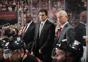 Mike Grier (left) is an assistant coach with the New Jersey Devils. (GETTY IMAGES)
