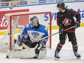 Finland goalie Justus Annunen lets in the fifth goal as Canada's Dylan Cozens looks on during second period semifinal action at the World Junior Hockey Championships on Saturday, Jan. 4, 2020 in Ostrava, Czech Republic. (THE CANADIAN PRESS/Ryan Remiorz)