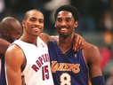Vince Carter and Kobe Bryant hug after a game. (SUN FILES)
