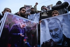 Protesters shout slogans against the United States and Israel as they hold posters with the image of top Iranian commander Qasem Soleimani, who was killed in a US airstrike in Iraq, and Iranian President Hassan Rouhani during a demonstration in the Kashmiri town of Magam on January 3, 2020. - Hundreds of people in Indian Kashmir staged