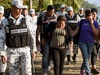 A Central American migrant family is escorted by members of the Mexican National Guard and officers of the Migration Institute after being detained crossing the Suchiate River, the natural border with Tecum Uman in Guatemala, in Ciudad Hidalgo, Chiapas State, Mexico on January 22, 2020. - The Mexican government tried to dialogue with the new caravan of Central Americans on Tuesday to prevent their irregularly entering and instead take a refuge and temporary employment programs in the south of the country. (Photo by ALFREDO ESTRELLA / AFP) (Photo by ALFREDO ESTRELLA/AFP via Getty Images)