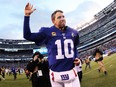 Giants quarterback Eli Manning waves to the crowd after beating the Dolphins at MetLife Stadium in East Rutherford, N.J., on Dec. 15, 2019.