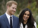 In this Monday Nov. 27, 2017 file photo, Britain's Prince Harry and his fiancee Meghan Markle pose for photographers during a photocall in the grounds of Kensington Palace in London.