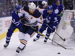 Oilers forward Connor McDavid controls the puck against the Maple Leafs during the second period at Scotiabank Arena in Toronto on Jan. 6, 2020.