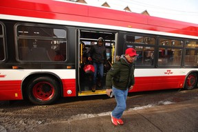 People disembark at Jane and Bloor Sts. from shuttle buses after a TTC subway car near Keele St. came off the rails on Wednesday, Jan. 22, 2020.