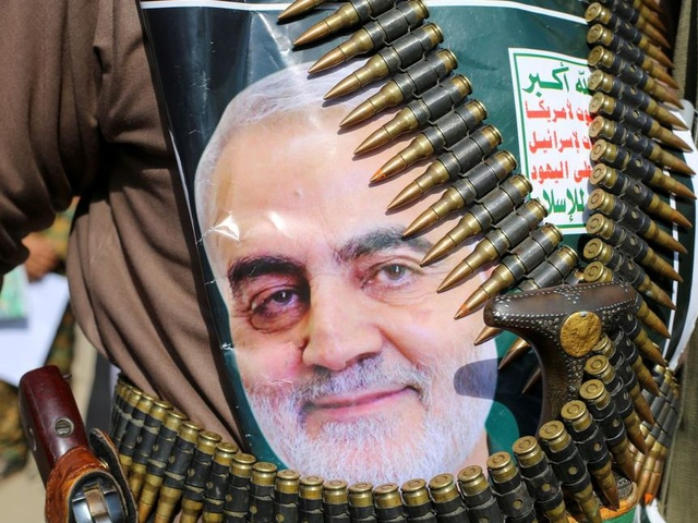 A supporter of the Houthis has a poster attached to his waist of Iranian Major-General Qassem Soleimani, head of the elite Quds Force, who was killed in an air strike at Baghdad airport, during a rally to denounce the U.S. killing, in Saada, Yemen January 6, 2020. The writing on the poster reads: