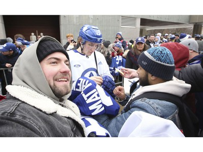 Toronto Maple Leafs held their annual outdoor practice at Nathan Phillips Square (Pictured) Toronto Maple Leafs Travis Dermott signs some autographs after the skate  in Toronto on Thursday January 9, 2020. Jack Boland/Toronto Sun/Postmedia Network