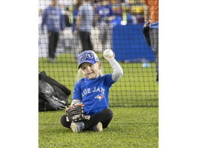 3 year old Maggie Chard, from Brantford tries out her baseball skills, as the Toronto Blue Jays' introduced their new look uniform today at Winter Fest.  Blue Jay  fans enjoyed the carnival atmosphere in a re-imagined Rogers Centre  in Toronto, Ont. on Saturday January 18, 2020. Stan Behal/Toronto Sun/Postmedia Network