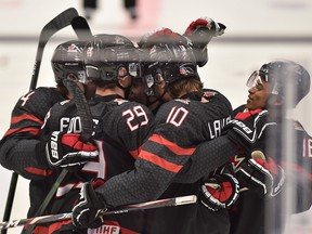 Canada players celebrate their second goal during the 2020 IIHF World Junior Ice Hockey Championships Group B match between Canada and Czech Republic in Ostrava, Czech Republic, on Dec. 31, 2019.
