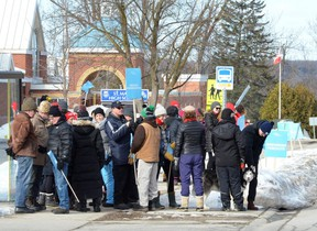 Members of the Ontario English Catholic Teachers Association picket outside St. Mary's High School on Tuesday in Owen Sound.
