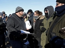 The Canadian National Police Service (CN Police) serve an injunction to pipeline protesters at a railway blockade in Edmonton. (Reuters)