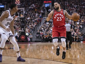 Toronto Raptors guard Fred VanVleet, left, controls a ball as Brooklyn Nets guard Spencer Dinwiddie defends during the first quarter at Scotiabank Arena in Toronto, Feb. 8, 2020. (Nick Turchiaro-USA TODAY Sports)