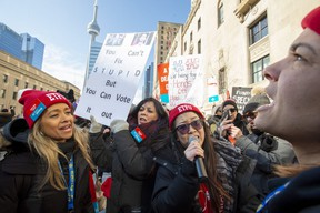 Striking school teachers protest outside a speech by Ontario Education Minister Stephen Lecce in Toronto on Wednesday, February 12, 2020. THE CANADIAN PRESS/Frank Gunn
