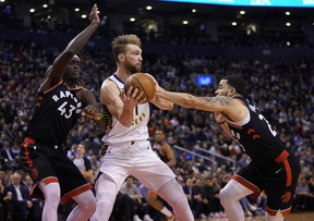 Pacers forward Domantas Sabonis is double-teamed by Pascal Siakam (left) and Fred VanVleet of the Raptors last night at Scotiabank Arena.John E. Sokolowski/USA TODAY