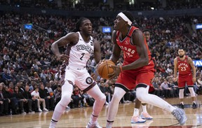 Raptors forward Pascal Siakam (right) controls a ball as Nets forward Taurean Prince defends at Scotiabank Arena last night.  Nick Turchiaro/USA TODAY Sports