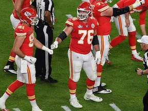 Guard for the Kansas City Chiefs Laurent Duvernay-Tardif (C-R) reacts during Super Bowl LIV between the Kansas City Chiefs and the San Francisco 49ers at Hard Rock Stadium in Miami Gardens, Florida, on February 2, 2020.