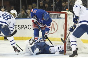 Rangers centre Filip Chytil (72) slides into the net as Toronto Maple Leafs goaltender Michael Hutchinson makes a save during the second period at Madison Square Garden on Wednesday night. (Sarah Stier/USA TODAY Sports)