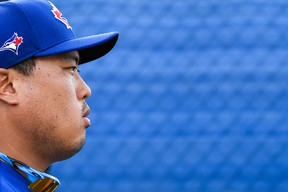 Blue Jays starting pitcher Hyun-Jin Ryu looks on during spring training workouts at Spectrum Field on Thursday. (USA TODAY SPORTS)