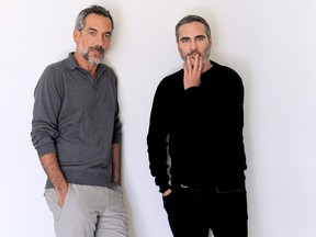 """This Sept. 20, 2019 photo shows director Todd Phillips, left, and actor Joaquin Phoenix during a portrait session for the film """"Joker,"""" at the Four Seasons Hotel in Beverly Hills, Calif. (AP Photo/Richard Hartog)"""