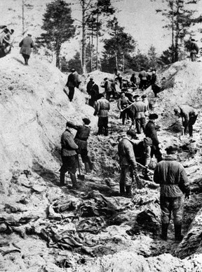 A picture taken on April 1, 1943, shows men digging out bodies of Polish officers from a mass grave in Katyn.(AFP/Getty Images)