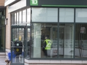 After a rash of bank robberies in and around the GTA, security has been stepped up at many branches. A security guard is seen here posted at the door to a TD branch near Don Mills Rd. and Lawrence Ave. E. in Toronto on Saturday, Feb. 15, 2020. (Stan Behal/Toronto Sun/Postmedia Network)