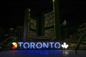 The Toronto sign at Nathan Phillips Square is illuminated in blue to mark the 185th anniversary of the City of Toronto,