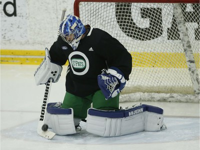 Toronto Maple Leafs Jack Campbell G (36) turns away a shot during practice in Toronto on Wednesday February 19, 2020. Jack Boland/Toronto Sun/Postmedia Network