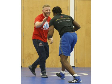 Clayton Pye (red T-shirt), a wrestler at Brock University, gets in some training with one of his teammates Iggy Pitt. Pye has overcome adversity after almost being fatally stabbed a few years ago, is well on his way to competing for Canada at the Olympics.  in Toronto, Ont. on Tuesday February 18, 2020. Jack Boland/Toronto Sun/Postmedia Network