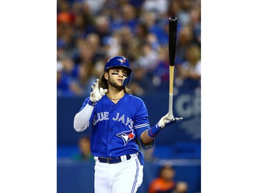 Bo Bichette #11 of the Toronto Blue Jays reacts after taking a strike in the first inning during a MLB game against the Houston Astros at Rogers Centre on September 1, 2019 in Toronto, Canada.