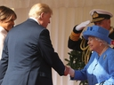 First Lady Melania Trump stands by as President Donald Trump shakes hands with Queen Elizabeth during the U.S. presidents trip to the U.K. on July 13, 2018. (AFP via Getty Images)