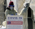 A COVID-19 Assessment Centre is set up outside of Scarborough Health Network - Birchmount Hospital on Saturday, March 21, 2020. (Veronica Henri/Toronto Sun/Postmedia Network)